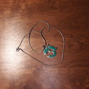 Turquoise and silver pendant.